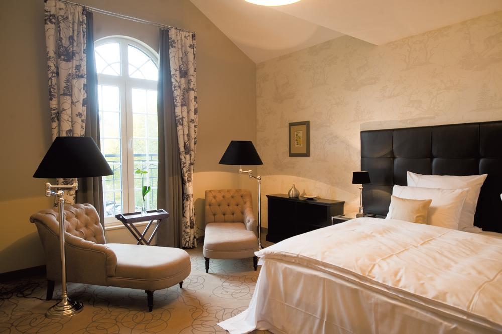 Die Zimmer und Suiten des Naturresort Schindelbruch bieten ein gemütlich-elegantes Ambiente