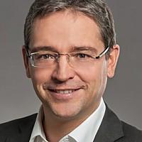 Dr.  Roger  Baumann